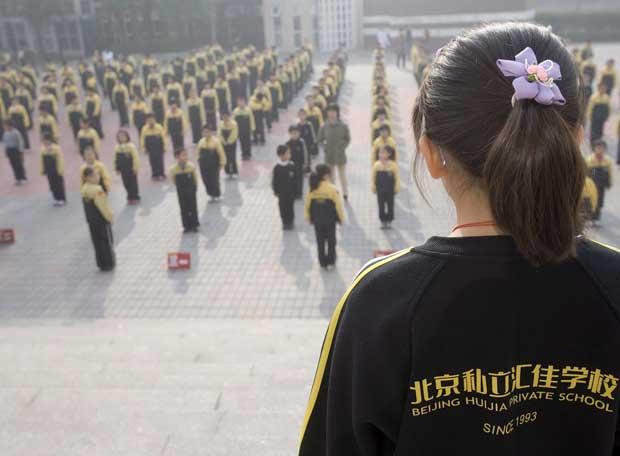 Estudiantes de primaria, en un centro escolar de Pekín