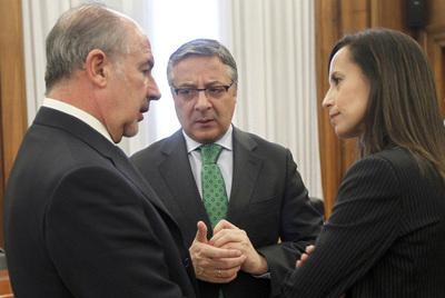 Rodrigo Rato, José Blanco y Beatriz Corredor