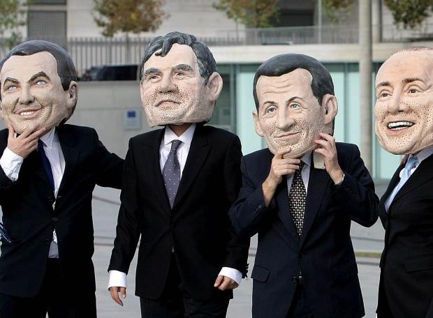 Activistas con cabezudos de Zapatero, Brown, Sarkozy, Berlusconi y demás líderes advierten de la responsabilidad de los gobernantes con el medio ambiente