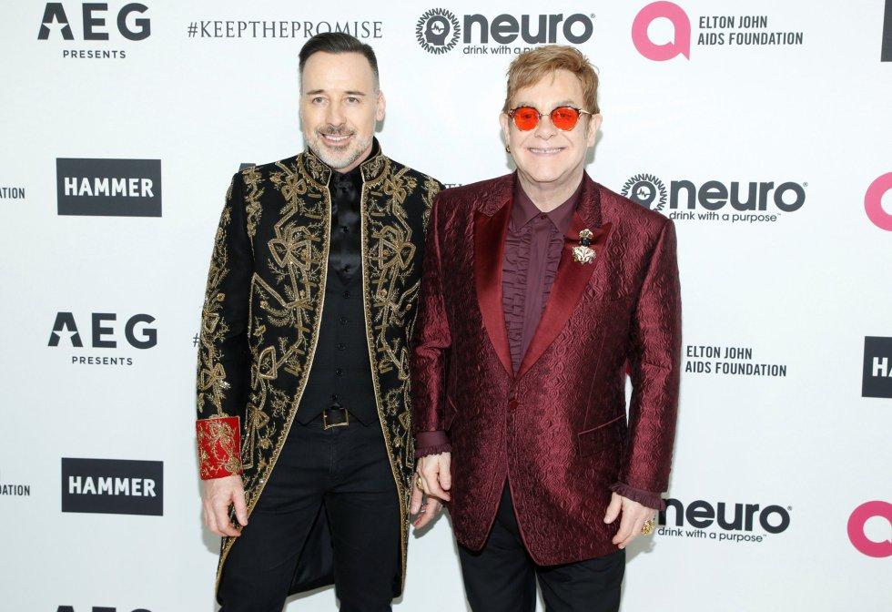 Elton John y su esposo David Furnish, los anfitriones de la noche.