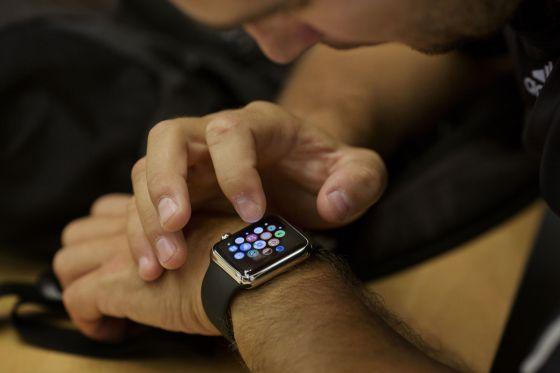 a2046f0072f An employee sets up an Apple Watch for a customer at an Apple Inc. store