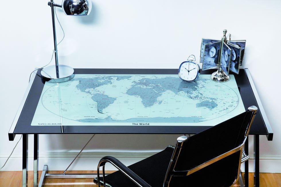 Fotos en casa mejor que en la oficina econom a el pa s for Mesa cristal mapamundi