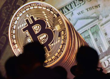 El bitcoin se encamina hacia los 6.000 dólares