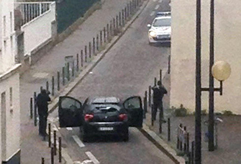 Fotos atentado contra el semanario sat rico charlie for Oficinas bankia cercanas