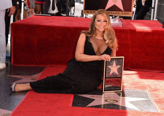 aa271e66e Mariah Carey, na Calçada da Fama de Hollywood, com sua estrela. Quando está