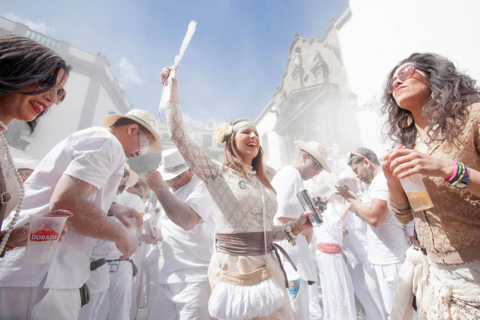 "Santa Cruz de La Palma (Canary Islands). This is one of the oldest and most traditional carnivals on the Canary Islands. It commemorates the return of the ""indianos,"" the local residents who emigrated to the Americas and came home after making a fortune. The locals wear white and use props such as cigars, caged parrots and wooden chests. The whole thing takes place to the rhythm of Caribbean music, and a recurring character is La Negra Tomasa, who is always played by an elderly resident of La Palma."