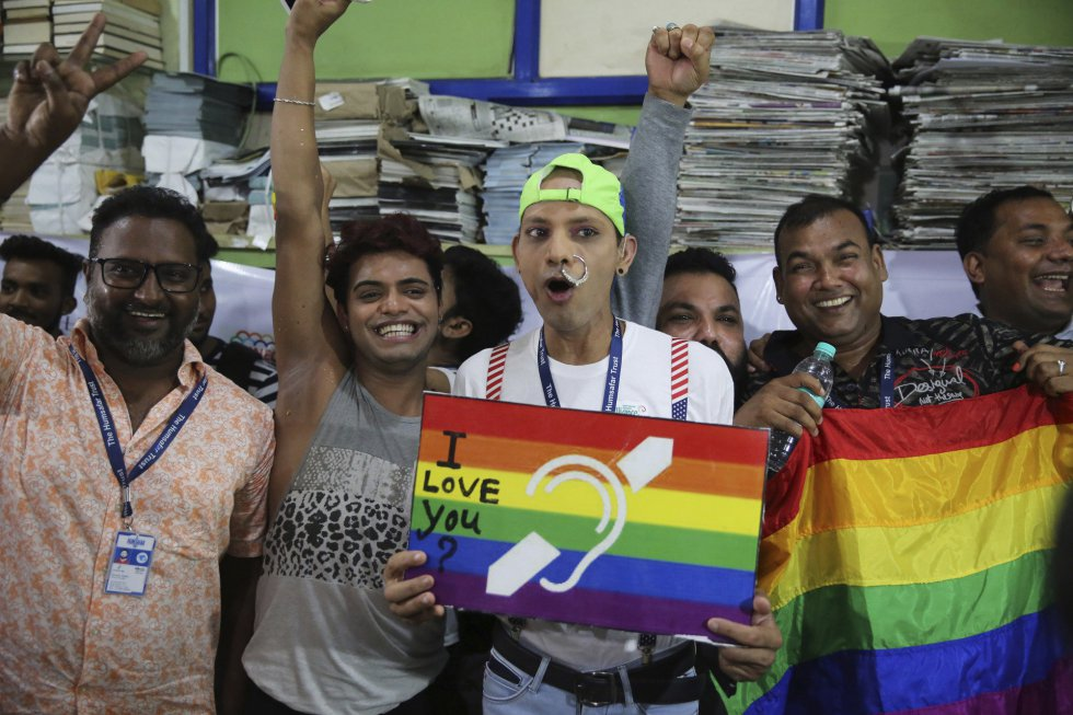 Supporters and members of the LGBT community celebrate the decriminalization of homosexuality in Bombay (India).