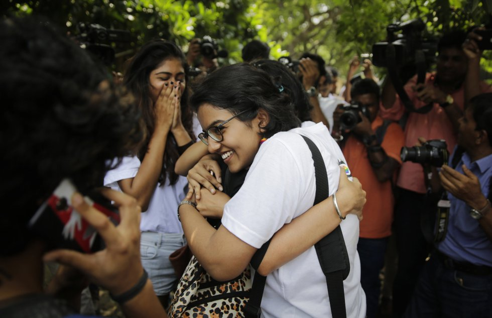 LGBT activists embrace after the ruling of the Indian Supreme Court that overturns a 2013 ruling that validated a 19th century British law that punished acts 'against nature' and criminalized same-sex relations with prison sentences