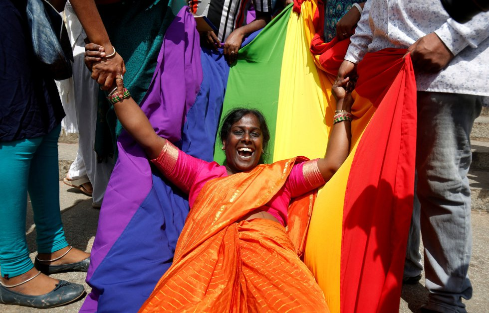 An activist on an LGBT flag celebrates the ruling of the Supreme Court in Bengaluru (India).