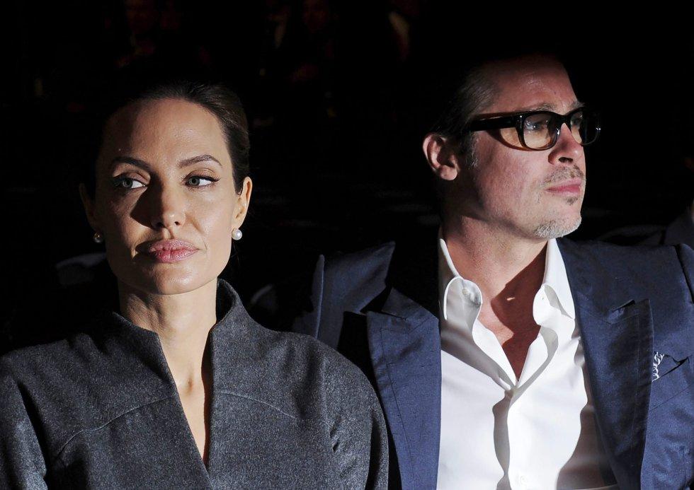 Angelina Jolie y Brad Pitt, a su llegada a la Cumbre Global para poner fin a la violencia sexual en conflicto celebrada en el centro Excel de Londres (Reino Unido), en 2014.